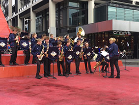 students playing music on red carpet